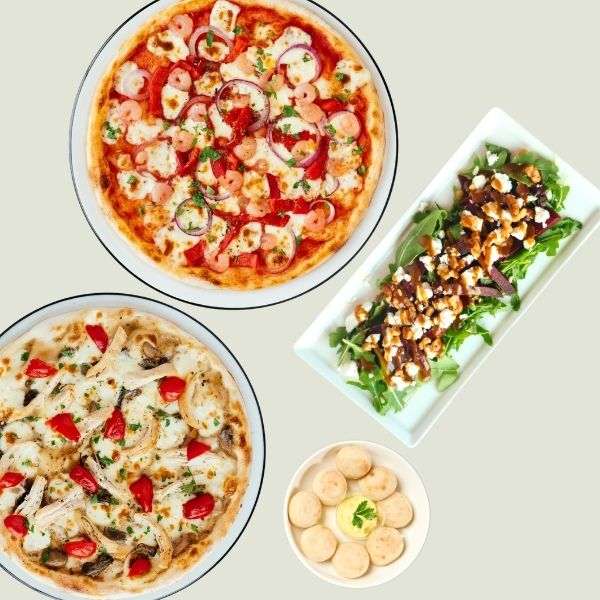 Two pizzas, a salad and dough balls from PIzza Express Cyprus