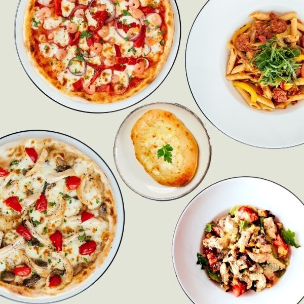 Two pizzas, pasta, a salad and dough balls from Pizza Express Cyprus